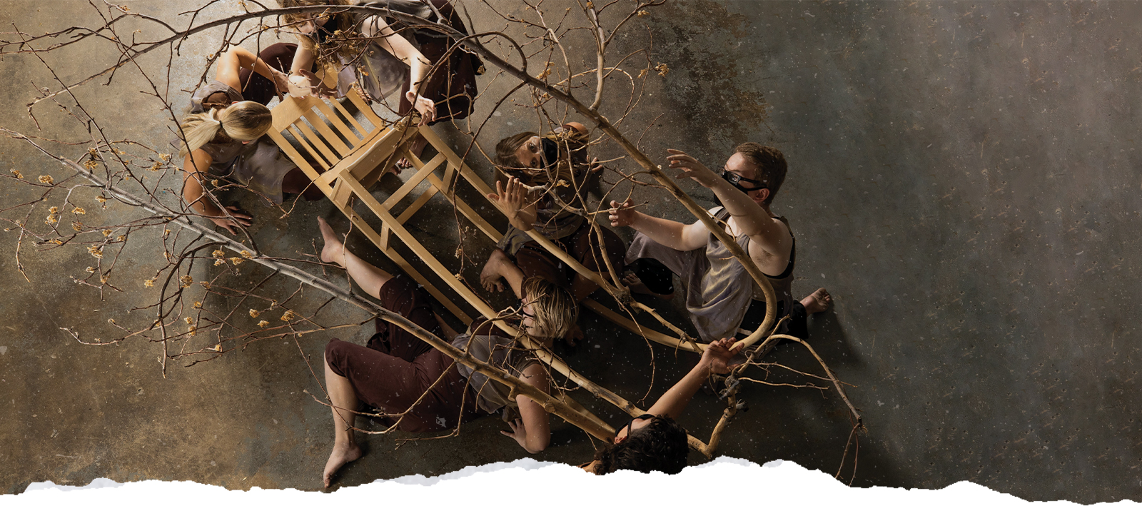 Dancers interact with a sculpture