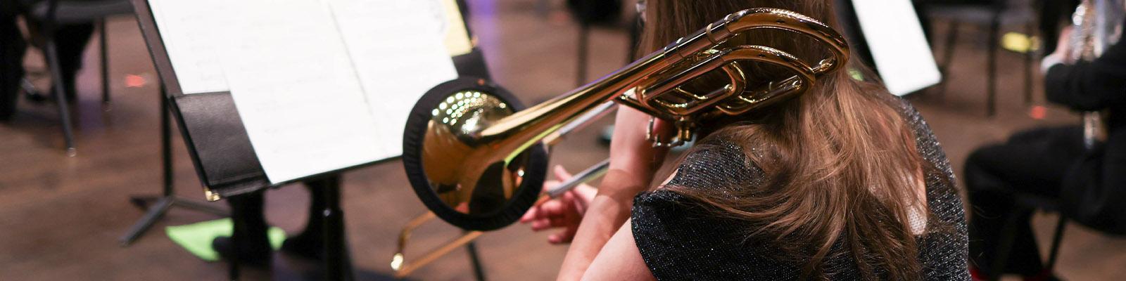 Studnet plays an instrument