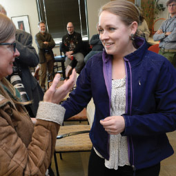 Jessica Schreifels Miller talking with a collegue