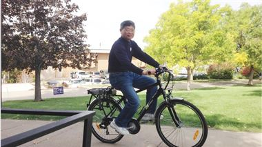 Fred Chiou, assistant professor in Electronics Engineering Technology, rides an electric bike around the Weber State Campus. The bike is part of a solar charging station for electric bikes and vehicles that will ultimately encourage sustainable commuting to the university.