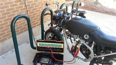 A motorcycle modified with an electric motor gets more juice at a solar charging station at the Weber State University in Ogden. A team of engineering students completed the charging station last spring. Their supervising assistant professor, Fred Chiou, would like to see several more added throughout the campus to encourage sustainable commuting.