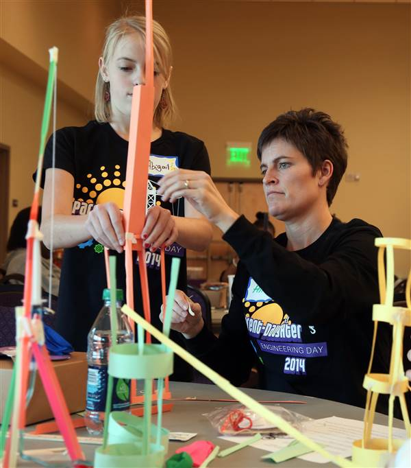 Abigail Christiansen, left, works on building a paper tower with her mother, Hannah Christiansen, during Parent-Daughter Engineering Day at Weber State University on Saturday, Nov. 15, 2014. Girls from 6th-9th grade spent the day doing experiments and learning about careers in engineering.
