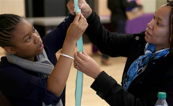Shanoah Murray, left, works on building a paper tower with her mother, Sharonda Murray, during Parent-Daughter Engineering Day at Weber State University on Saturday, Nov. 15, 2014. Girls from 6th-9th grade spent the day doing experiments and learning about careers in engineering.