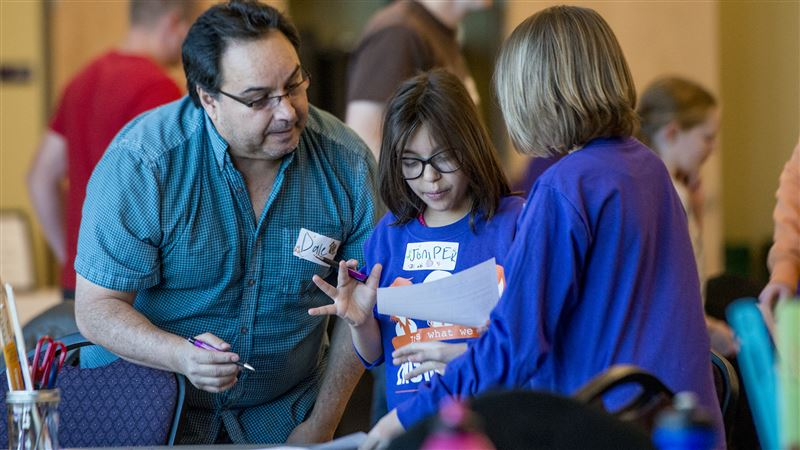 Dale Espinoza helps his daughter Juniper, center, and her best friend Ashlynn Flackman, right, try to engineer a way to protect a human head using an egg as the test subject Saturday, Nov. 14, 2015, during the Parent/Daughter Engineering Day at Weber State University in Ogden.