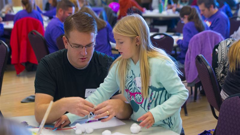 Evan Lunt and daughter Julie work together to engineer a way to protect a human using a egg Saturday, Nov. 14, 2015, during Parent/Daughter Engineering Day at Weber State University in Ogden.