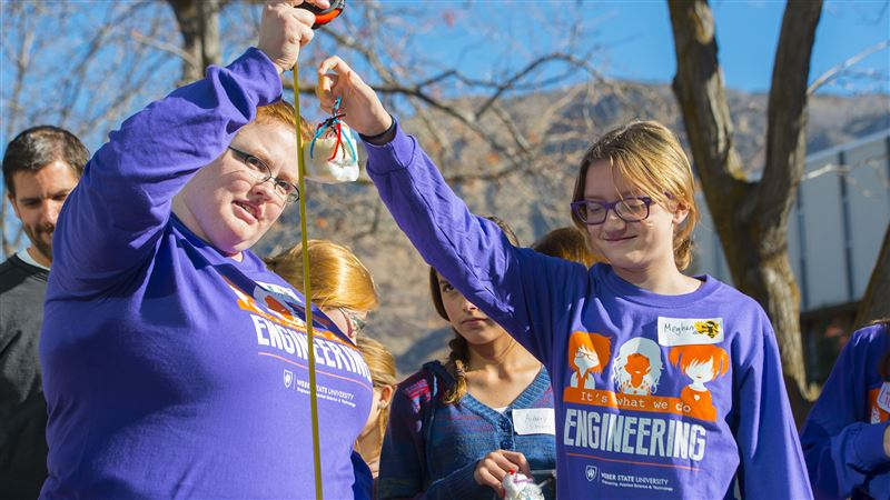 Meghan Walter, right, prepares to drop her egg in its protective case as Kira Shelton, left, makes sure its dropped at a distance of five feet Saturday, Nov. 14, 2015, at Weber State University in Ogden.