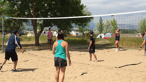 students at experience weber playing volleyball