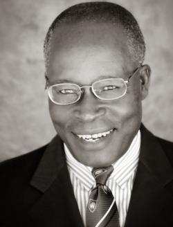 John M. Mbaku