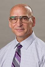 Dr. Mark L .Huson
