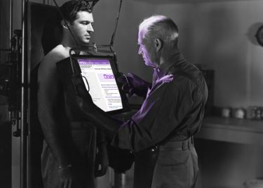 a doctor examining a patient with xray technology