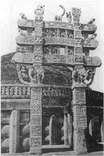 Black and white photograph of an elegant stone gateway in India.