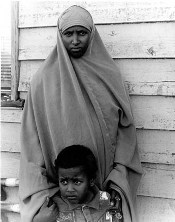 Photo of a refugee woman and child.