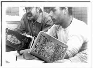 photo of men reading a book of poetry.