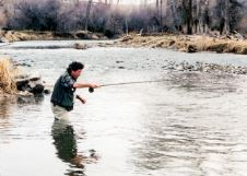 Photo of David James Duncan fly fishing.