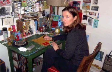 Photo of artist Meri DeCaria at work.